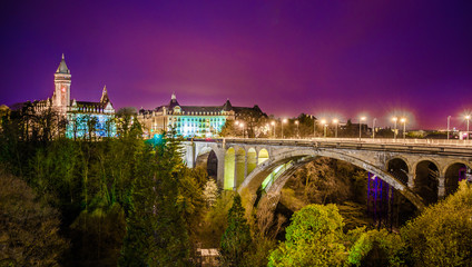 Night view over bridge leading to place de metz, luxembourg.
