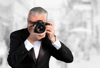 Photographer, camera, artistic.