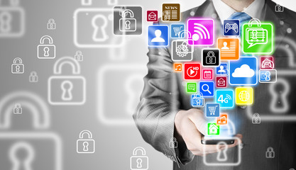 Business man using smart phone with social media icon set