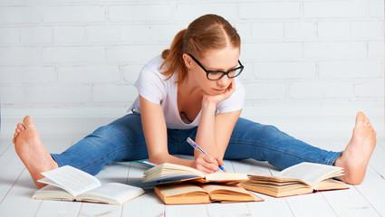 happy girl student preparing homework, preparing for the exam wi
