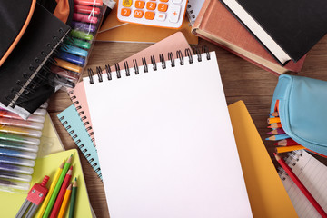Busy student's desk with blank sketch pad