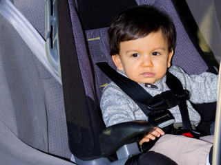 Young Male Toddler In Car Seat