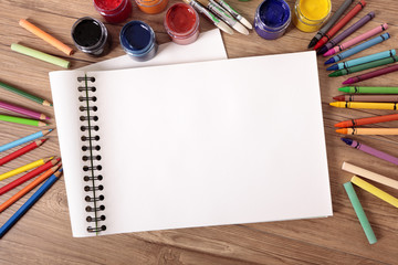 School supplies with blank art book