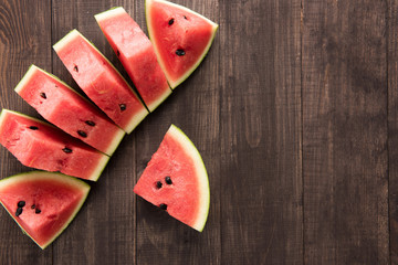 Slices of fresh watermelon on wooden background