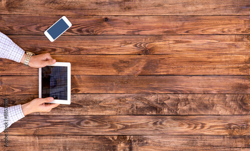 From Above Image Man Browsing Gadget At Empty Wood Desk Natural Directly Top