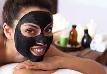 Young beautiful woman in a mask for the face of the therapeutic