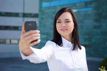 beautiful business woman making selfie photo on smartphone
