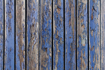 wooden texture with peeling blue paint
