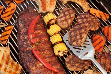 Spareribs, Steaks, Hamburger Patties, Corn And Pepper On The Gri