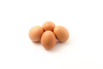 Four eggs in group isolate on white