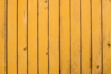 Yellow wood peeling paint texture