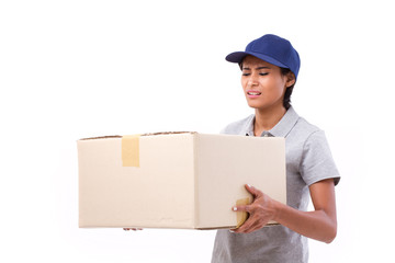female delivery staff carrying heavy parcel carton box