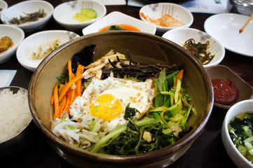 Traditional Korean dish bi bim bap with pickled and fresh vegetables and egg.