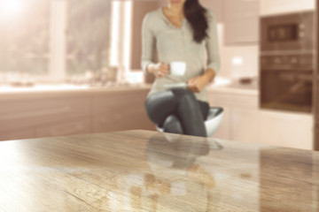 wooden desk space and woman with cup of coffee