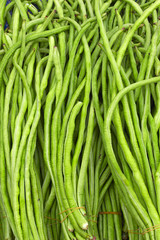 Thai cuisine, green beans on a market stall