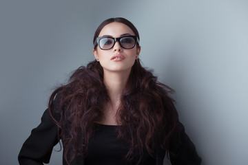 Beauty shot of a woman in stylish shades.