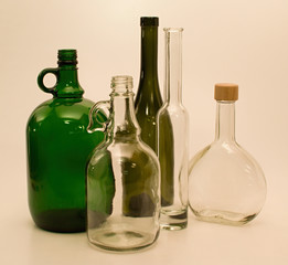 Green and white glass bottles