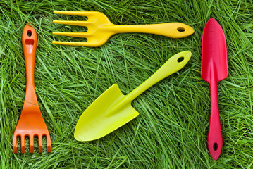 Set of gardening tools on grass