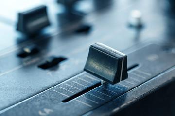 Crossfader on dj mixer in club