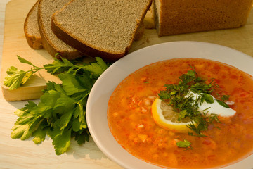 Solyanka soup with lemon and sour cream