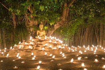 Printed kitchen splashbacks Buddha Buddhist monk fire candles to the Buddha with beautiful water reflection in Phan Tao Temple, Chiangmai, Thailand.