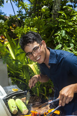 man barbecuing in his garden