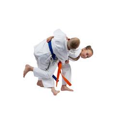 Active sportswoman is doing judo throw