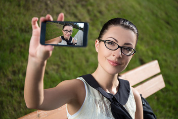 beautiful woman making selfie photo on smart phone