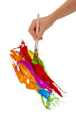 Colored splashing brush on white background