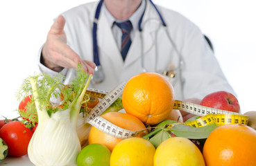 Doctor nutritionist showing healthy fruits and vegetables