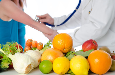 Doctor nutritionist giving a diet plan to his patient