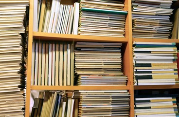 many books piled up for sale in the great library