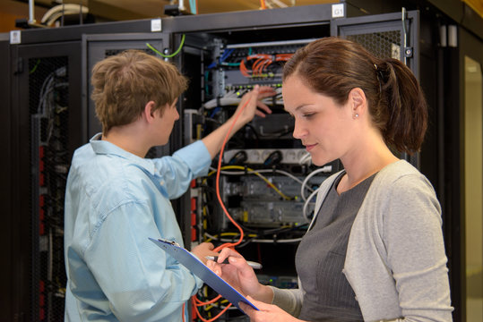 Team of IT specialists in datacenter