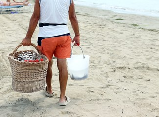 seller on the beach with fruit skewers made with fresh fruits