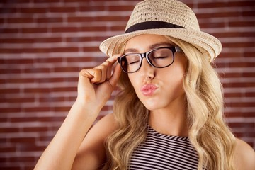 Gorgeous blonde hipster sending air kiss