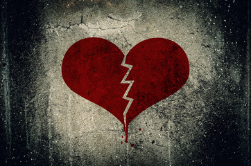 Heart broken painted on grunge cement wall background - love con