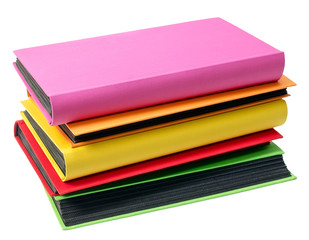The pile of colored photo albums on wite backround