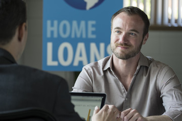 Caucasian male in a home loans office