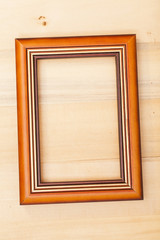 Classic wooden frame on wood background