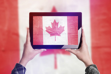 Taking Picture of Canada Flag with Digital Tablet