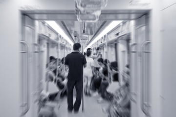 Passengers inside subway cars