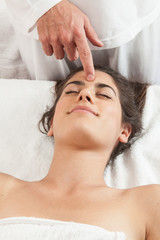 Relaxed woman gets a massage on her head