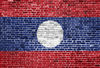 Flag of Laos painted on brick wall, background texture