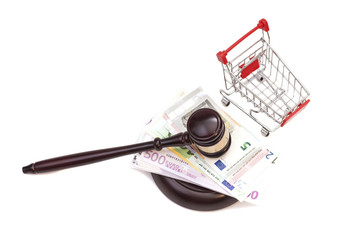 Hammer of judge, pushcart and euro money isolated on white backg