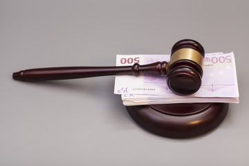 Judge gavel and euro banknotes isolated on gray