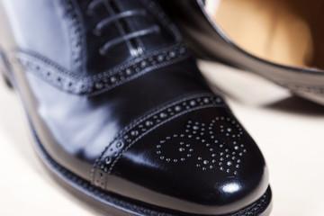 Closeup of Pair of Male Stylish Black Polished Oxford Semi-Brogu