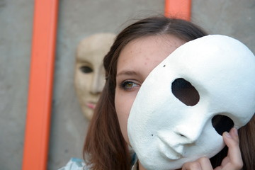 brunette with a white theatrical mask on white background