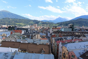 Aerial view of Innsbruck city taken from City Tower (Stadtturm) which was built in 1450 in Tirol, Austria. With 51 meters of height, City Tower is located in Old City (Altstadt or Altestadt).