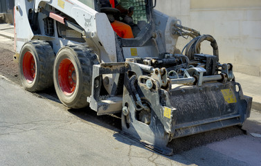 Milling of asphalt for road reconstruction accessory for skid steer