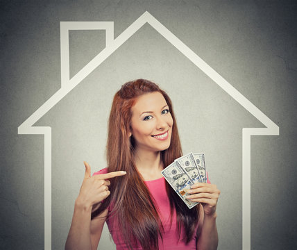 home, money, people concept. Successful business woman holding dollar cash money
